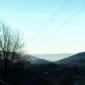 Гледка от пътя Мърчаево Владая - в далечината се вижда килимът над София